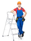 Craftsman with tools and stairs Stock Images