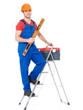 Craftsman with tools and stairs Royalty Free Stock Photography