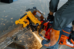 Craftsman using machines cutting steel rail.  Stock Images