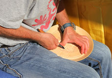 Craftsman who carves a dish. A craftsman who carves a dish Royalty Free Stock Image