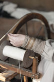 Craftsman who spins the wool Royalty Free Stock Image