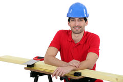 Craftsman with wood lath. And saw Stock Photos