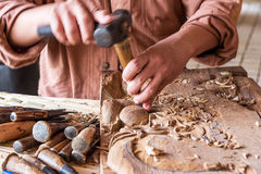 Craftsman wooden carving. Royalty Free Stock Image