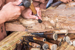 Craftsman wooden carving. Royalty Free Stock Images