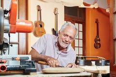 Craftsman woodworking royalty free stock photos