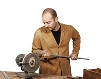 Craftsman work at grinder Stock Image