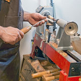 Craftsman at work  latheing wood Royalty Free Stock Photo