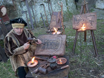 Craftsman at work in a living nativity scene Royalty Free Stock Images