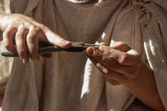 Craftsman at work. Craftsman's hands with instument. Master is making something Royalty Free Stock Photography