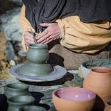 Craftsman at work to make a clay pot. Stock Photography