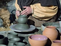 Craftsman at work to make a clay pot. Craftsman at work to make a clay pot on a turntable Royalty Free Stock Photo