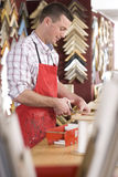 Craftsman working on frame in frame shop Royalty Free Stock Photos