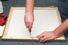 Craftsman working on frame in frameshop. Copy space. Top view Royalty Free Stock Photos