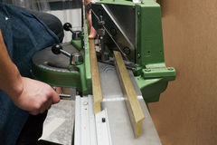 Craftsman working on frame in frameshop. Professional framer hand holding frame angle. Top view Royalty Free Stock Images