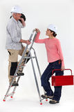 Craftsman working with his apprentice Royalty Free Stock Photos