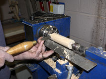 Craftsman working on a lathe Stock Images