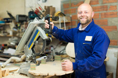 Craftsman working with unfinished guitar Royalty Free Stock Photo
