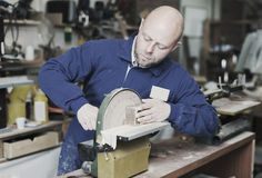 Craftsman working with unfinished guitar Stock Photo