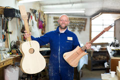 Craftsman working with unfinished guitar Stock Images