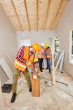 Craftsman working with wood. And buliding new house royalty free stock photo