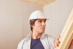 Craftsman working with wood. At construction site Stock Photo
