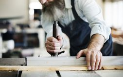 Craftsman working in a wood shop Royalty Free Stock Image