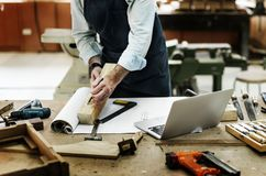 Craftsman working in a wood shop Stock Image