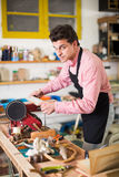 Craftsman working on woodworking machine Stock Photography