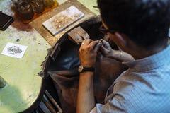Craftsman working on workbench Royalty Free Stock Photo