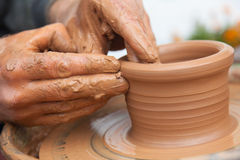 Craftsman works in clay dishes Royalty Free Stock Photos