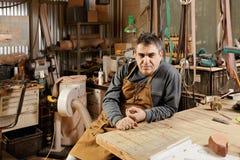 Craftsman in workshop Stock Image