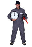 Craftsman with wrench and clock Stock Photos