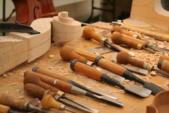 Craftsmanship. Workbench with tools for making wooden musical instruments royalty free stock photo