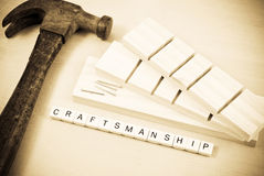 Craftsmanship. Spelled On Small Wooden Blocks With Hammer Stock Photo