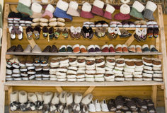 Craftsmanship background. Homemade slippers and boots selling on the market stand Royalty Free Stock Photo