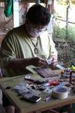The craftsmanship. Inlaid amulet image of buddha stock photos