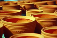Craftsmanship: pottery. Clay bowls in a row staying to dry in the sun Royalty Free Stock Image