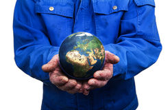 Craftsmanship saves the world. Craftman holding the world in his hands Stock Photos