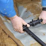 Craftsmen combines geothermal pipes Royalty Free Stock Photo