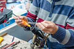 Craftsmen creates of colored glass miniature figurine of an unicorn Royalty Free Stock Photo