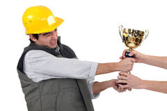 Craftsmen fighting for a golden cup Stock Photos