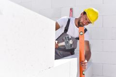 Craftsmen at home construction - bricklayers working in work clo. Thes Stock Photography