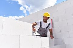 Craftsmen at home construction - bricklayers working in work clo. Thes Stock Image