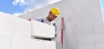 Craftsmen at home construction - bricklayers working in work clo. Thes - portrait Royalty Free Stock Image