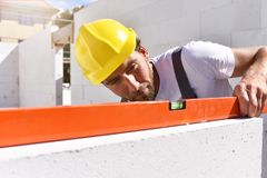 Craftsmen at home construction - bricklayers working in work clo. Thes Stock Photo