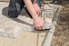 Craftsmen laid paving stones Royalty Free Stock Photo