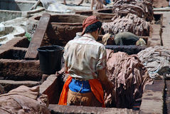 Craftsmen at a leather tannery, Morocco Stock Photos