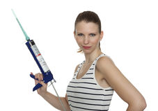 Craftswoman with a caulking gun Stock Photography