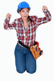Craftswoman clenching her fists Stock Photo