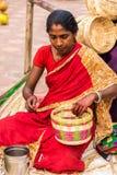 Craftswoman creating cane baskets Stock Photo
